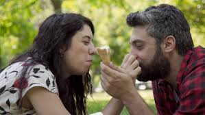 attractive young Couple in love at park eat ice cream flirt slomo    p A Shutterstock