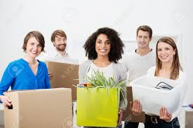 group of friends moving house working as a team carrying boxes group of friends moving house working as a team carrying boxes and packages of household items