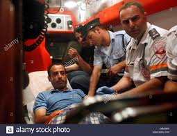 an i medic r and police officer sit beside nadim injas l an i medic r and police officer sit beside nadim injas l inside an ambulance in tel aviv before being evacuated to hospital 17 2010