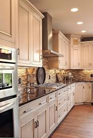 kitchen paint colors with cream cabinets: light cabinets dark counter oak floors neutral tile black splash i could easily paint then glaze the existing cabinets and add a backsplash