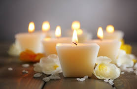 Image result for candle and flowers for funerals