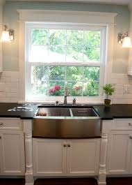 sink windows window love: love the detail around the window and the sconces flanking it plus the backsplash