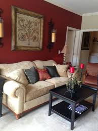 deep red accent wall gold accents and dark furniture love the wall sconces also match red to my drapery fabric black furniture wall color
