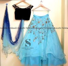 Beautiful lehenga in <b>sky blue</b> color with dark off shoulder blouse in ...
