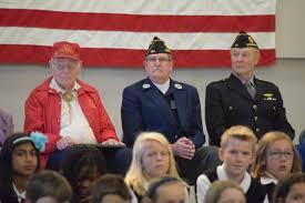 principal s blog our students honored our veterans by writing essays on the meaning of the flag singing armed forces medley s participating in a flag folding ceremony and