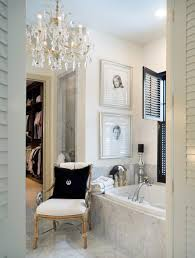 small bathroom chandelier crystal ideas: bathroom sconces complement the oversized crystal and shade chandelier bathrooms with chandeliers