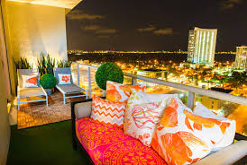 view in gallery plants and colorful seating on a modern balcony balcony furniture miami