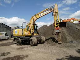 komatsu tractor construction plant wiki fandom powered by wikia pw130es of se davis son fitted a hydraulic hammer for breaking oversize material for the crusher