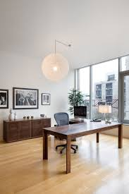 vanillawood trendy home office photo in portland with white walls light hardwood floors and a freestanding bathroomoutstanding black staples office furniture lshaped