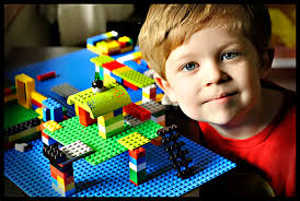Kid Playing with LEGO blocks - Kid-Playing-with-LEGO-blocks