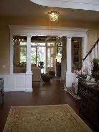 columns like this to separate the gym area from the game room still lets in ample light the pool table side could have seating benches built in beautiful living room pillar