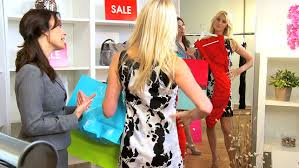 caucasian female paying sales assistant in exclusive boutique with        young w  paying  s assistant in exclusive boutique   credit card   hd stock video clip