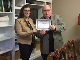 essay contest spring — saint gabriel respect lifeerin scanlon accepts her first place  senior division award from fr  bender  read her essay here