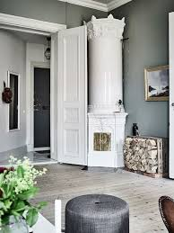 perfect accent pieces compliment a swedish kakelugn harmony and balance in a swedish home with green ac