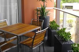 narrow planters and compact furniture make maximum use of a small balcony ad small furniture ideas pursue
