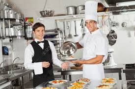 food server stock photos pictures royalty food server food server waiter taking customer s food from chef stock photo