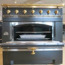 black appliance matte seamless kitchen: matte black lap cornue  with brass trim