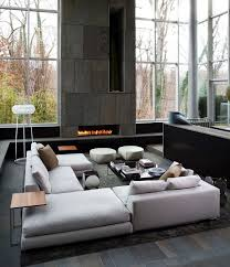 ideas contemporary living room: mum likes the dark stone next to the glass for the outdoor fire place middot living room moderncontemporary