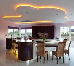kitchen ceiling lighting design. exclusive modern kitchen joining with dining area orange hiding light curvaceous island ceiling lighting design