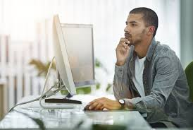 examples of male privilege in all areas of life everyday a person sits at a desk looking pensively at a computer screen