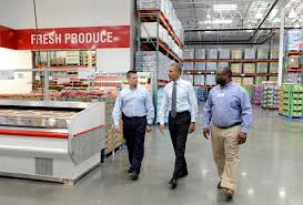 lanham md at costco obama touts his plan to boost wages us president barack obama c is escorted by costco employees ray quevedo l