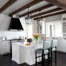 calacatta marble kitchen waterfall: stunning and chic white kitchen with calacatta marble countertops