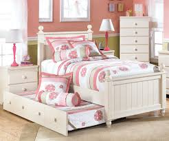 cottage retreat poster bed by ashley furniture cream finish bed with trundle ashley furniture bedroom photo 2