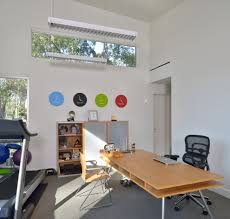 piney point ranch minimalist home office photo in houston with white walls carpet and a freestanding brick desk wall clock