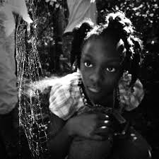time photo essay – chicago    s food security and urban agriculture    mariah examines a spider web in eddie harris    s garden  harris  a local artist  has converted his lawn into a unique garden in which he paints on trees and