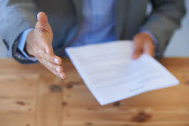 examples of salary history and requirements letters man holding resume reaching out hand for handshake