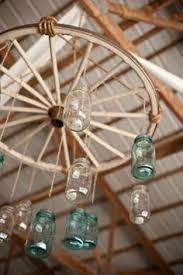 one option for the wagon wheel i can add flowers to the actual wheel and have them drapingdripping off but we could also suspend mason jars with some alternating length wagon wheel mason jar