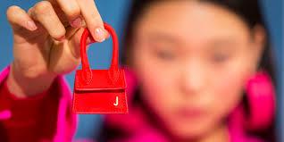 Models wear <b>tiny</b> handbags on their fingers at Paris <b>Fashion</b> Week ...