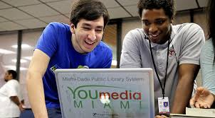 Newsela   Homework takes over the library for kids without Internet College mentor David Paez  left       a student at the Art Institute of Miami  works with Lavingston Humes      on a laptop that is provided for students in