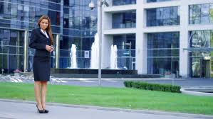 a beautiful young caucasian business woman walking outside office building stock footage video 1402720 shutterstock beautiful office building