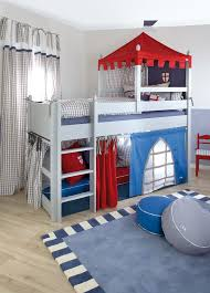 this boys bedroom in nice grey blue and red tones doubles as a fun playroom boy bedroom ideas rooms