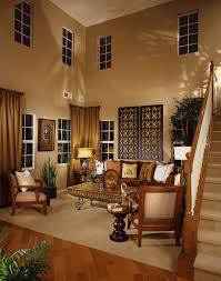 furniture living room wall: living room tucked into alcove adjacent to staircase the area has  story ceiling