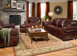 elegant brown leather havertys sofa and rectangle wooden table plus rug on wooden floor matched with chic living room leather