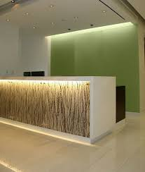 reception desk with artistic feature backlit and reflects the effect of the top lit acrylic lighted reception desk reception counter design