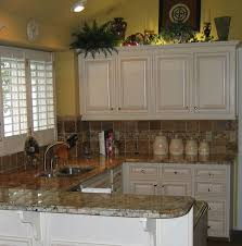 reface maple biscuit with glaze granite tops tile backsplash above cabinet lighting above cabinet lighting