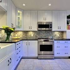 white kitchen cabinets with under cabinet lighting and mosaic tile backsplash for modern kitchen cabinets and cabinet lighting modern kitchen