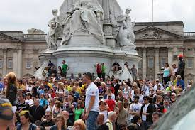 england style steps: fans who arrived early got prime viewing straight down the mall from the steps of the victoria memorial