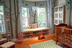 baby boy bedroom images: this nursery features lush natural wood flooring and crib with tree painting wall details paired