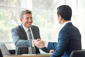 What to Ask HR After You Get a Job Offer | On Careers | US News Businessmen shaking hands in meeting