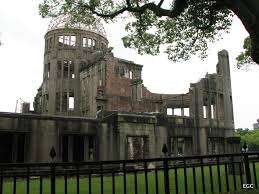 remembering hiroshima sifting before our eyes rose a bold testament to the events of 6 1945 windowless broken brick walls and the bare frame of a dome showed us what once had