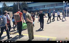 putin s reign of terror cossacks attack navalny women cossack menacing navalny and fbk group just before larger attack anapa airport