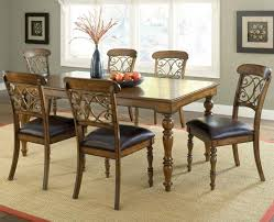 simple vintage wooden dining table with traditional upholstered black leather classic carving back chair at dining beautiful dining room furniture