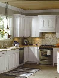 limestone tiles kitchen: unusual limestone kitchen backsplash with mosaic pattern kitchen backsplash and white wooden kitchen cabinets and double door kitchen cabinets along with