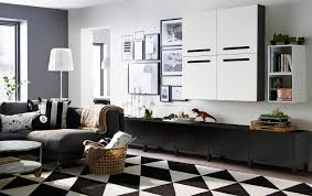 furniture living room wall: a large livingroom with black brown low storage with drawers and black brown wall