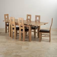 delivery dorset natural real oak dining set: dorset natural real oak dining set ft quot extending table with  wave back and brown leather chairs