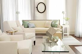 cream couch living room ideas: small white living room design with glass coffee table surrounded leather armchair furniture and cream long sofa ideas and stripes area rug